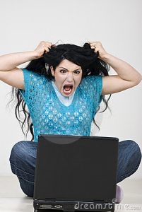 angry-woman-pulling-out-hair-front-laptop-13951257